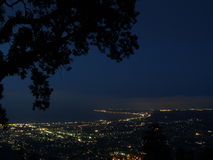 Town lights in night. A view from a hill stock photography