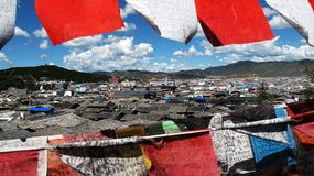 A town looking through colorful Tibetan talisman flag. royalty free stock images