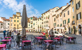 Town of Lucce, Italy. Lucca, Italy - Oct 6, 2016. In the center square of Lucca, Italy. Early morning visitors started tour before restaurant set up Royalty Free Stock Photography