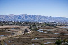 Town and marshland in south San Francisco bay area; Mission, Monument and Allison peaks in Diablo mountain range in the background. Don Edwards Wildlife Refuge stock image