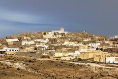 The town Matmata in Tunisia. Amid lightning sky Stock Photos