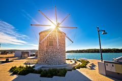 Town of Medulin windmill landmark and waterfront view Royalty Free Stock Images