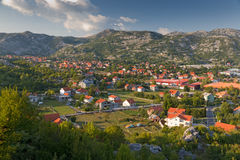 Town in Montenegro. Typical town with red roofed houses in green valley in warm later afternoon light, Montenegro Royalty Free Stock Images