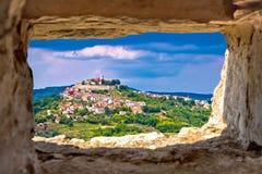 Town of Motovun on pictoresque hill of Istria. Through stone window, Croatia Stock Photo