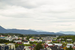 Town with mountains in background. Norwegian town with mountains in background Stock Image
