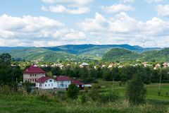 Town in the mountains. City in the mountains Ukrainian carpathians green trees Royalty Free Stock Image