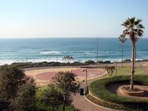 Town of Netanya. Israel. Landscapes of the coastline of the Mediterranean Sea. Panorama of the Mediterranean coast near the resort town in the early morning stock images