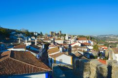 The town of Obidos. The town of Obidos is located on a hill and is still encircled by a fortified wall. The well-preserved medieval look of its streets, squares stock image