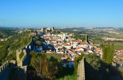 The town of Obidos. The town of Obidos is located on a hill and is still encircled by a fortified wall. The well-preserved medieval look of its streets, squares stock images