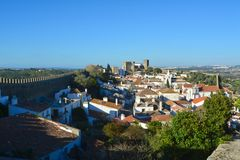 The town of Obidos. Is located on a hill and is still encircled by a fortified wall. The well-preserved medieval look of its streets, squares, walls and its stock photography
