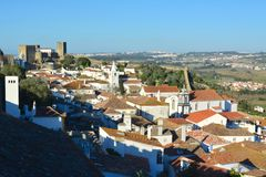 The town of Obidos. Orange. The town of Obidos is located on a hill and is still encircled by a fortified wall. The well-preserved medieval look of its streets royalty free stock photos