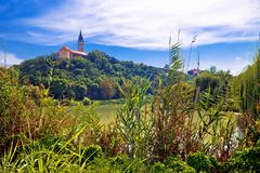 Free Town Of Ilok Church On The Hill Above Lake Stock Photo - 129812470