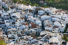Town of Ojen near Marbella in Spain early morning. Pretty hillside town of Ojen near Marbella in Spain  showing compact and pueblo style housing Royalty Free Stock Images