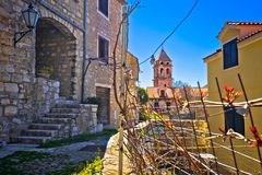 Town of Omis old stone mediterranean street and church view Stock Image