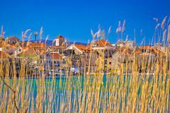 Town of Omis view through sedge on Cetina river Royalty Free Stock Image