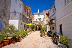 Town of Omisalj old mediterranean street view stock photo