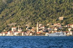 Town of Perast and yacht in the rays of setting sun. Montenegro Stock Photos