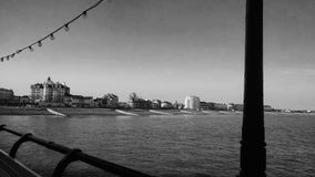 Town from a pier in black and white Stock Image