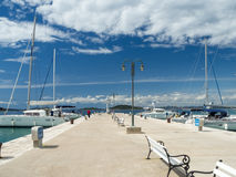 Town pier in Zlarin island in Croatia, port marine with yachts and catamarans. Spring time royalty free stock photo