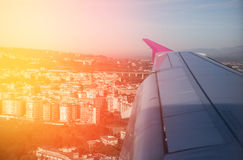 Town from plane window. Sunrise Royalty Free Stock Photography