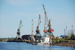 Town port with coal at Kolyma river outback Russia Royalty Free Stock Photos