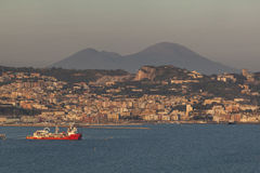 Town Pozzuoli with Vesuvius. POZZUOLI, ITALY - APRIL 16, 2014: Old town Pozzuoli in Campagna with volcano Vesuvius in background Stock Photo