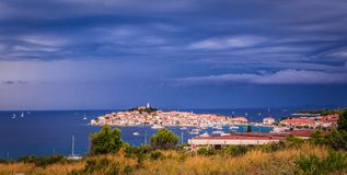 Town Primosten in Croatia. Dark Blue Sky Over The Shore Royalty Free Stock Image