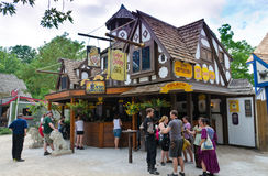 Town Pub. Tourists in line at a Bavarian-style outdoor pub at a Renaissance festival Stock Image