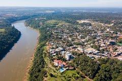 Town of Puerto Iguazu city centre aerial view. Fraternity Bridge border crossing Brazil-Argentina over the Iguassu River. stock photo