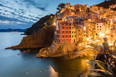 Town of Riomaggiore at night. Italian town by the seaside of Chinque Teree natioanal park stock image
