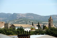 Town rooftops, Cabra. View over the church tower and rooftops towards the mountains, Cabra, Cordoba Province, Andalusia, Spain, Western Europe Stock Photo