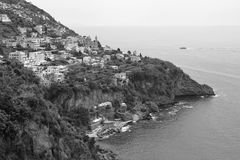 Like a Dolphin, Coastline of the town of Praiano, Amalfi Coast, Italy. The town`s name derives from the praia, or beach, from the Latin word pelagium, meaning ` stock photo