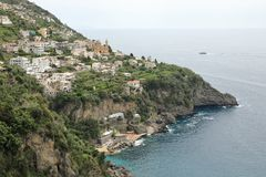 Coastline of the town of Praiano, Amalfi Coast, Italy. The town`s name derives from the praia, or beach, from the Latin word pelagium, meaning `open sea.` During stock images