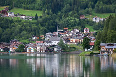 The town on the shore of a mountain lake Stock Image