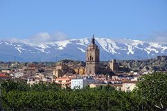Town and Sierra Nevada mountains, Guadix, Spain. View of the town and Cathedral with the snow capped mountains of the Sierra Nevada to the rear, Guadix, Granada Royalty Free Stock Photography