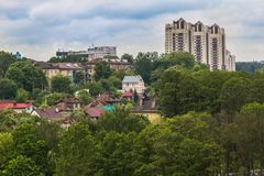 Town sight on hill. Town sight with trees and high and low rise buildings Royalty Free Stock Photography