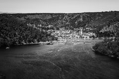 Town of Skradin on Krka river in Dalmatia, Croatia viewed from distance Stock Images