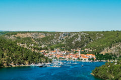 Town of Skradin on Krka river in Dalmatia, Croatia viewed from distance Stock Photo