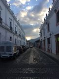 TOWN, SKY WITH LIGHT BATHING THE CLOUDS royalty free stock photography