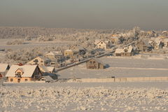 Town in the snow. Snow covers the village, frozen trees and bushes,  houses in snow Stock Images