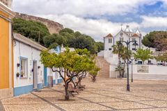 Town Square and the Church of Our Lady of the Martyrs, Castro Marim, Portugal. The attractive town square and the Church of Our Lady of the Martyrs overlooked stock image