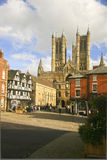 Town Square, Lincoln, Lincolnshire, UK. The town square with people standing around, walking and sight seeing with the tower of the Lincoln Cathedral in the Royalty Free Stock Photography