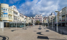 Town Square in Nazare Portugal. Cobblestoned town square with outdoor restaurants in the fishing village of Nazare, Portugal Stock Images