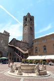 Town square Piazza Vecchia and old city tower Torre Civica in Bergamo, Citta Alta Stock Images