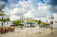 The town square of Skyros island. Sporades islands. Rainy day and heavy sky over the town square of Skyros island. Sporades islands . Greece Royalty Free Stock Photography
