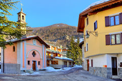 Town square and small chapel in Limone Piemonte. Small town square surrounded by typical houses and chapel in popular tourist ski resort of Limone Piemonte in royalty free stock image