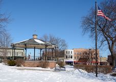 Town Square. This is a Winter picture of the town square in Woodstock, Illinois.  This town square features a gazebo and a flag which were part of the Bill Stock Photos