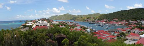 Town in St. Barts in the West Indies. Town and calm waters on the island of St. Barts in the West Indies royalty free stock image