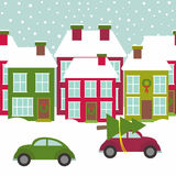 Town street with houses and cars in winter time Stock Photography