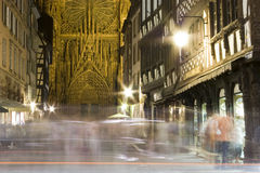 Town street in strasbourg and cathedral by night. Busy street of old town strasbourg in france by night historical buildings and cathedral Royalty Free Stock Photography